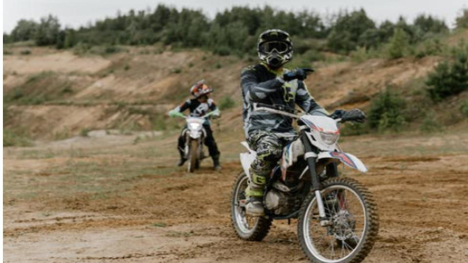 man on a dual sport motorcycle