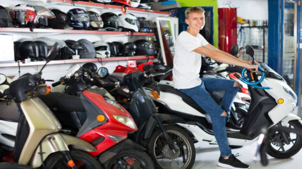 man riding a motorcycle in a dealer store