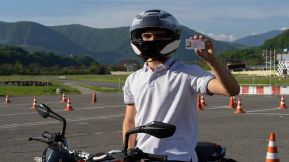 motorcycle rider showing driver's licence